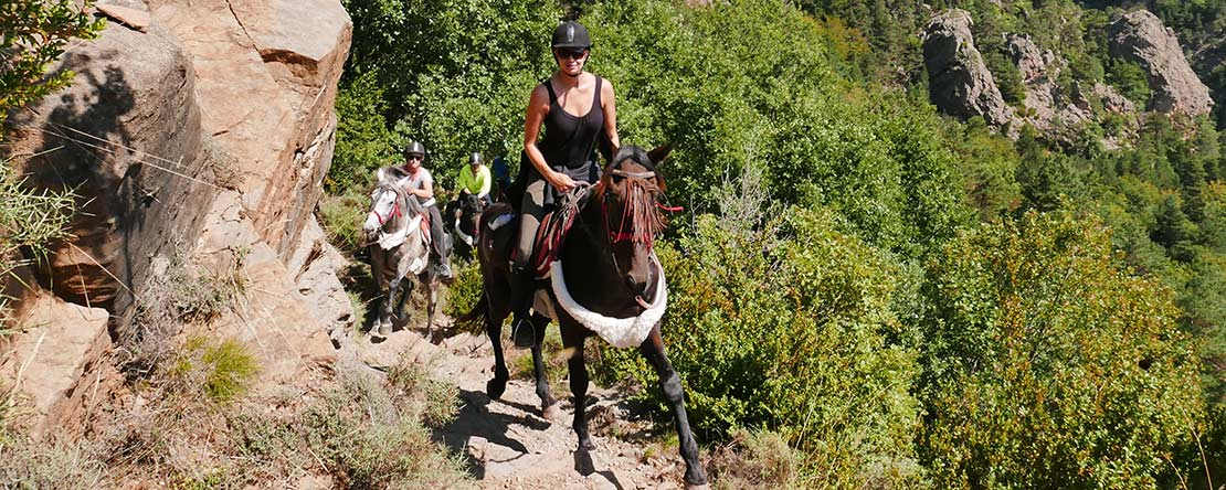 Climbing riding Pyrenees mountains